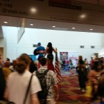 Captian America and Woman Wonder on stilts